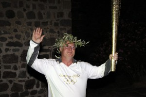 Thomas carrying the 2012 Olympic Torch
